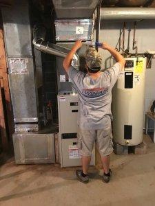 Twin Air Technician Servicing an Oil Burner